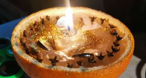 yule prosperity candle